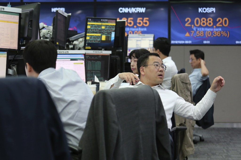 A currency trader gestures at the foreign exchange dealing room of the KEB Hana Bank headquarters in Seoul, South Korea, Thursday, Oct. 24, 2019. Asia...