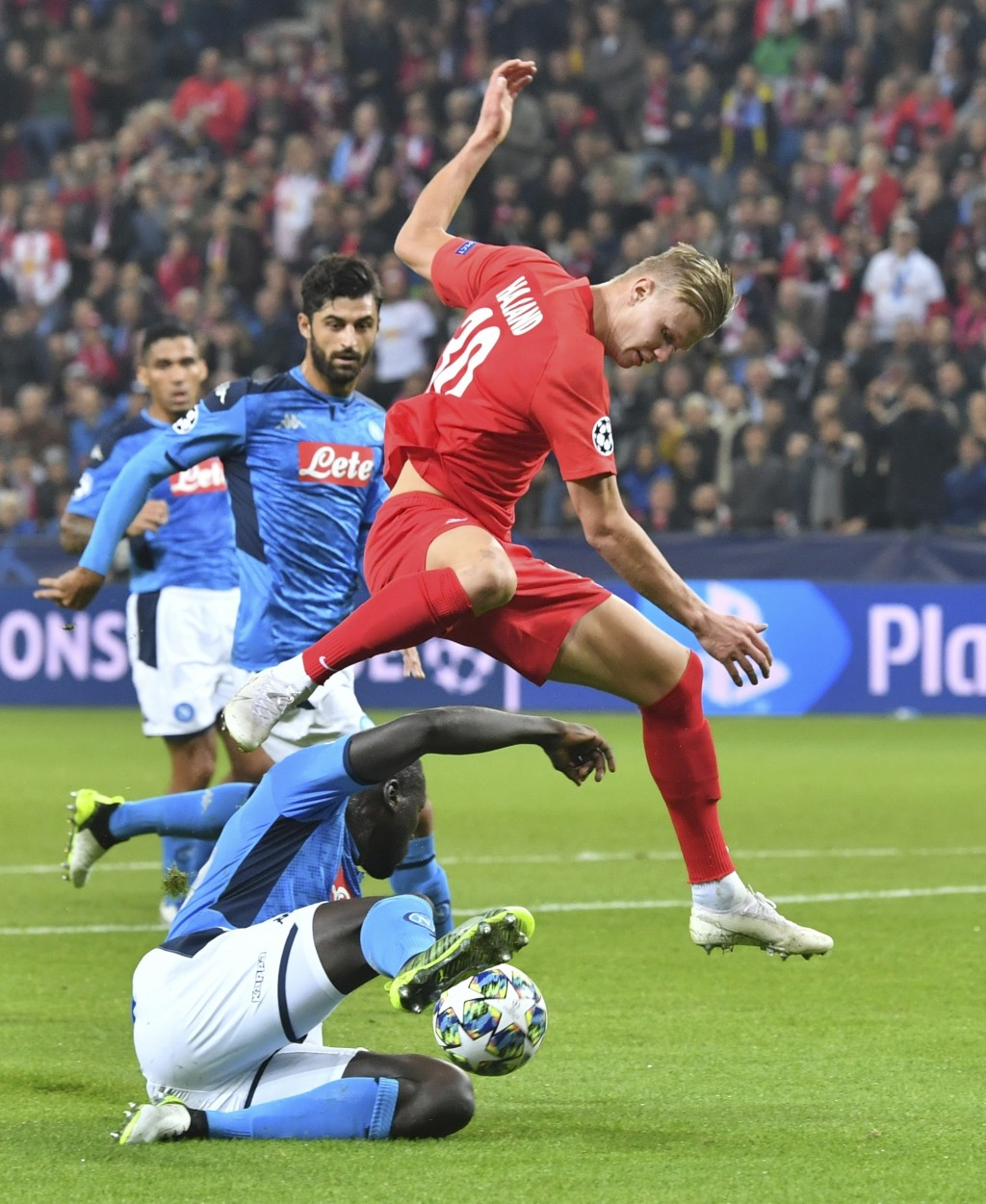 Salzburg's Erling Braut Haaland, atop, duels for the ball against Napoli's Kalidou Koulibaly during the Champions League Group E soccer match between ...