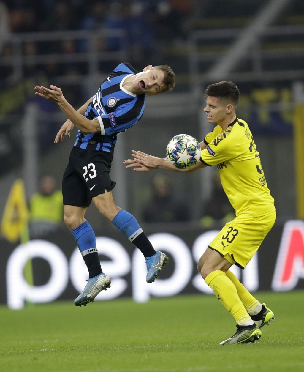 Inter Milan's Nicolo Barella, left, and Dortmund's Julian Weigl fight for the ball during the Champions League, Group F soccer match between Inter Mil...