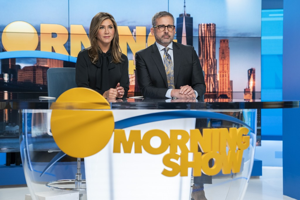 """This image released by Apple TV Plus shows Jennifer Aniston, left, and Steve Carell in a scene from """"The Morning Show,"""" debuting Nov. 1, as part of th..."""