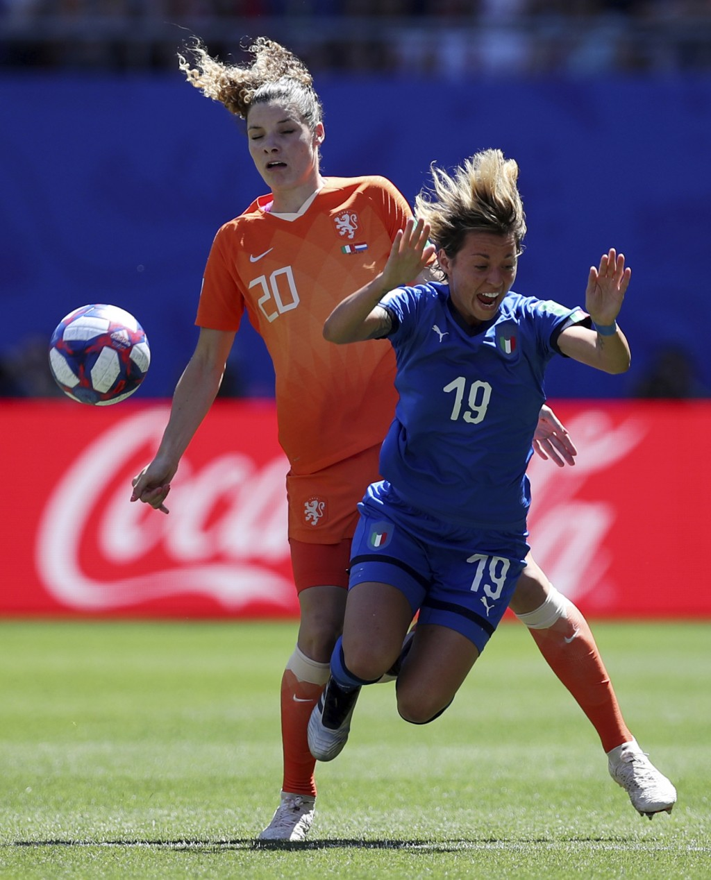 FILE - In this June 29, 2019 file photo, Netherlands'Dominique Bloodworth, left, challenges Italy's Valentina Giacinti, during a Women's World Cup qua...