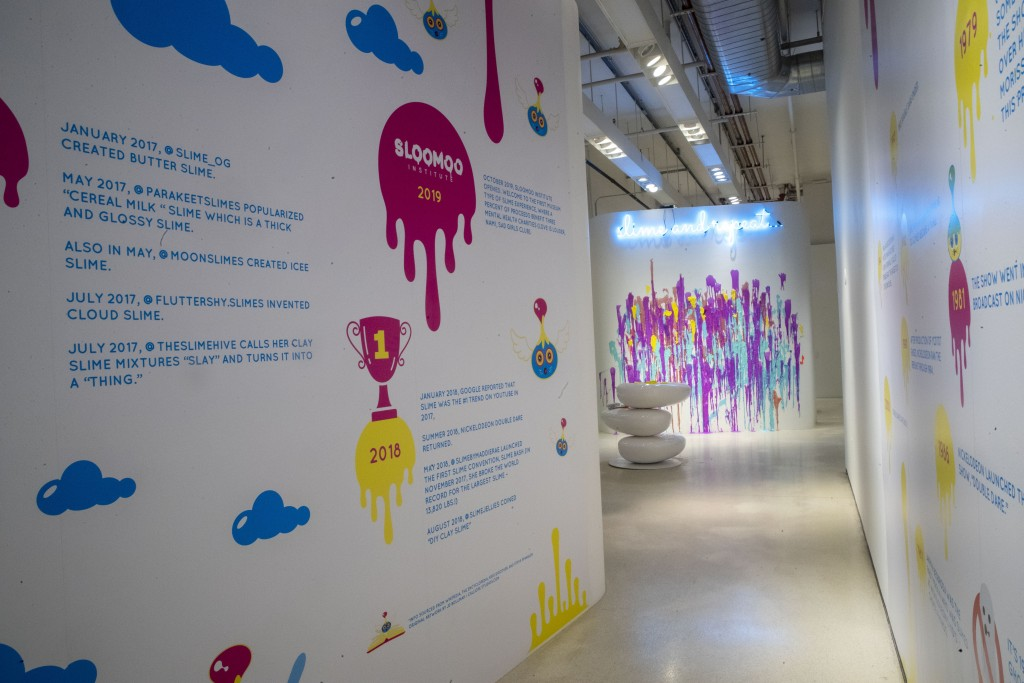 This Oct. 21, 2019, photo shows a timeline of the history of slime during a preview of the Sloomoo Institute in New York. An immersive, 8,000-square-f...