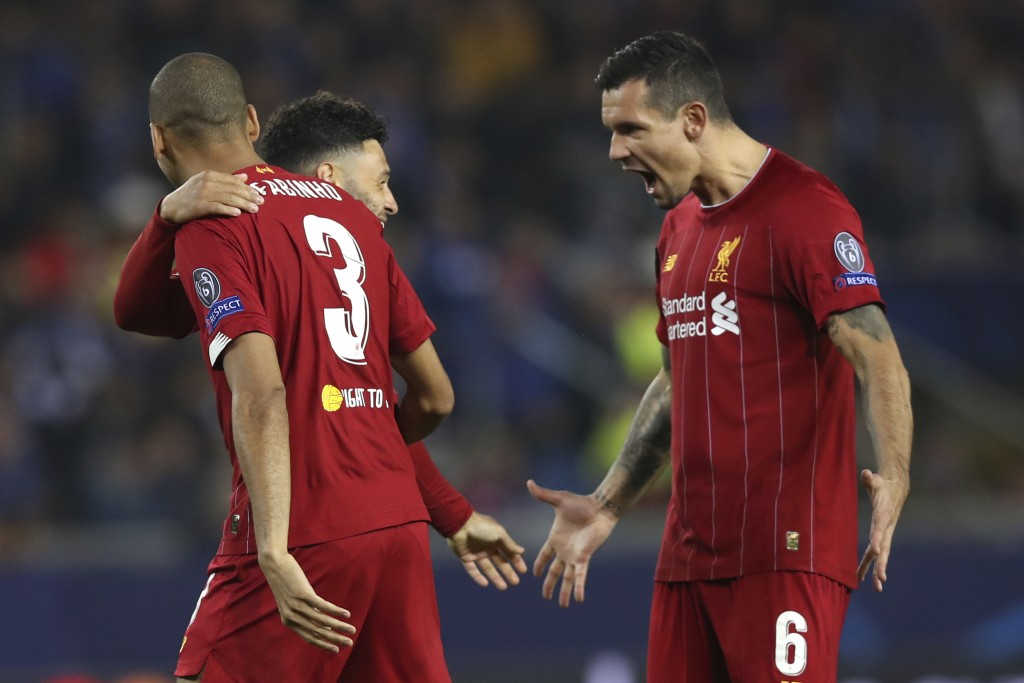 Liverpool's Alex Oxlade-Chamberlain, center, celebrates with Liverpool's Fabinho, left, and Liverpool's Dejan Lovren, right, after scoring the opening...