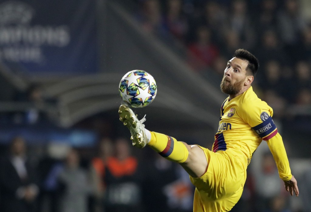 Barcelona's Lionel Messi kicks the ball during the Champions League group F soccer match between Slavia Praha and FC Barcelona at the Sinobo stadium i...