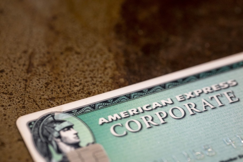 FILE - This Aug. 11, 2019, file photo shows an American Express card in New Orleans. Launched in 1969, the Green Card gave travelers a sense of import...