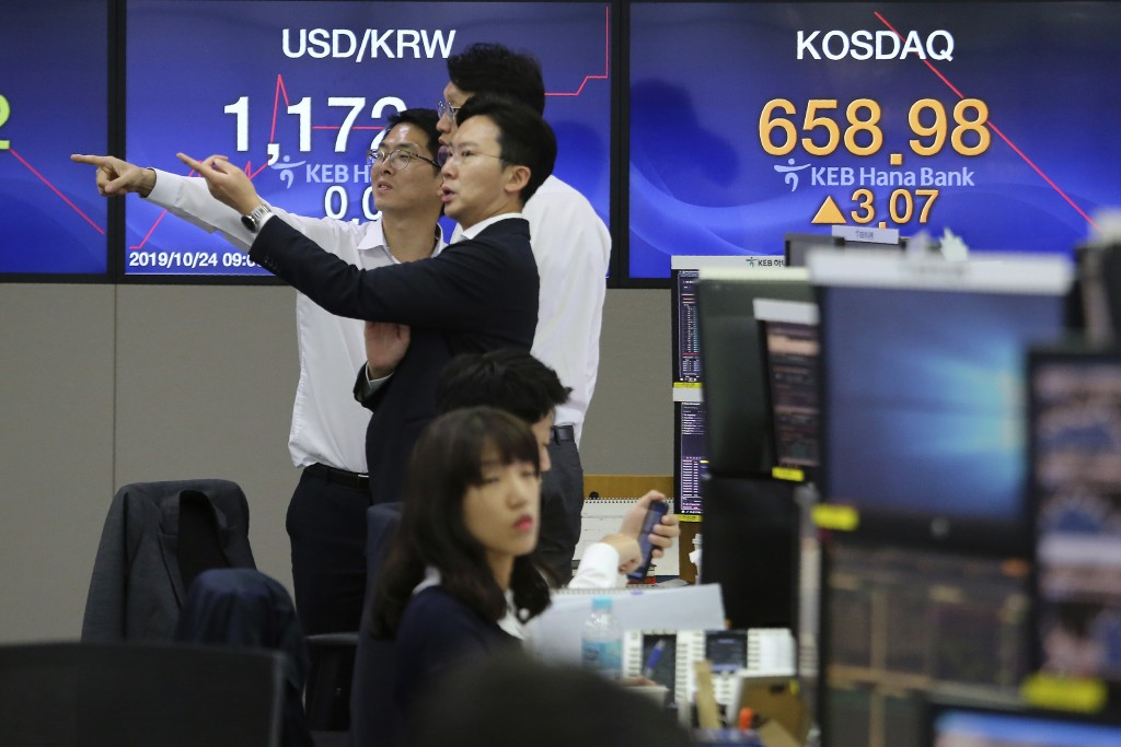 Currency traders gesture at the foreign exchange dealing room of the KEB Hana Bank headquarters in Seoul, South Korea, Thursday, Oct. 24, 2019. Asian ...