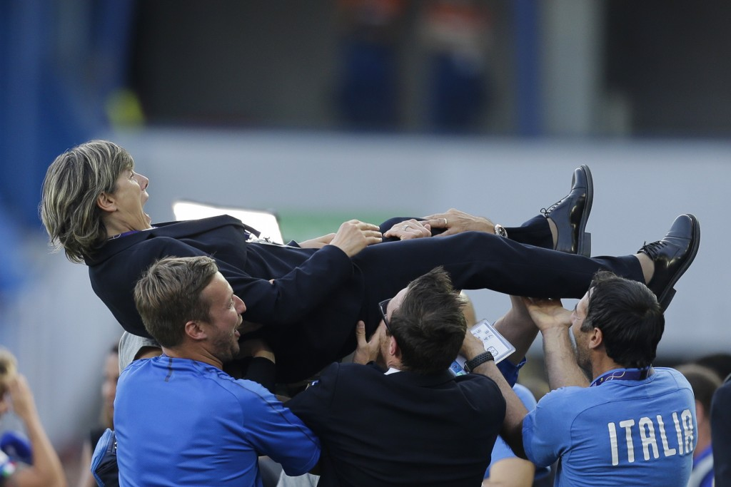 FILE - In this June 25, 2019 file photo, Italy head coach Milena Bertolini is thrown into the air by members of her team after winning 2-0 at the Wome...