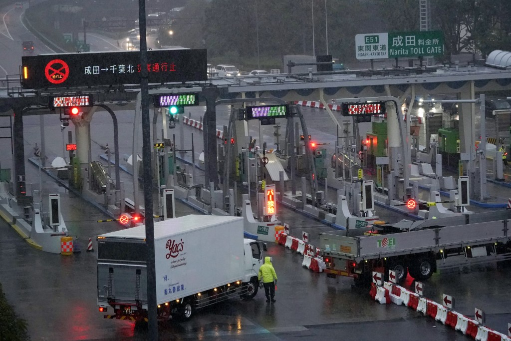 A toll gate of an expressway near Narita International Airport is closed due to heavy rain Japan, Friday, Oct. 25, 2019. Torrential rain from a low-pr...