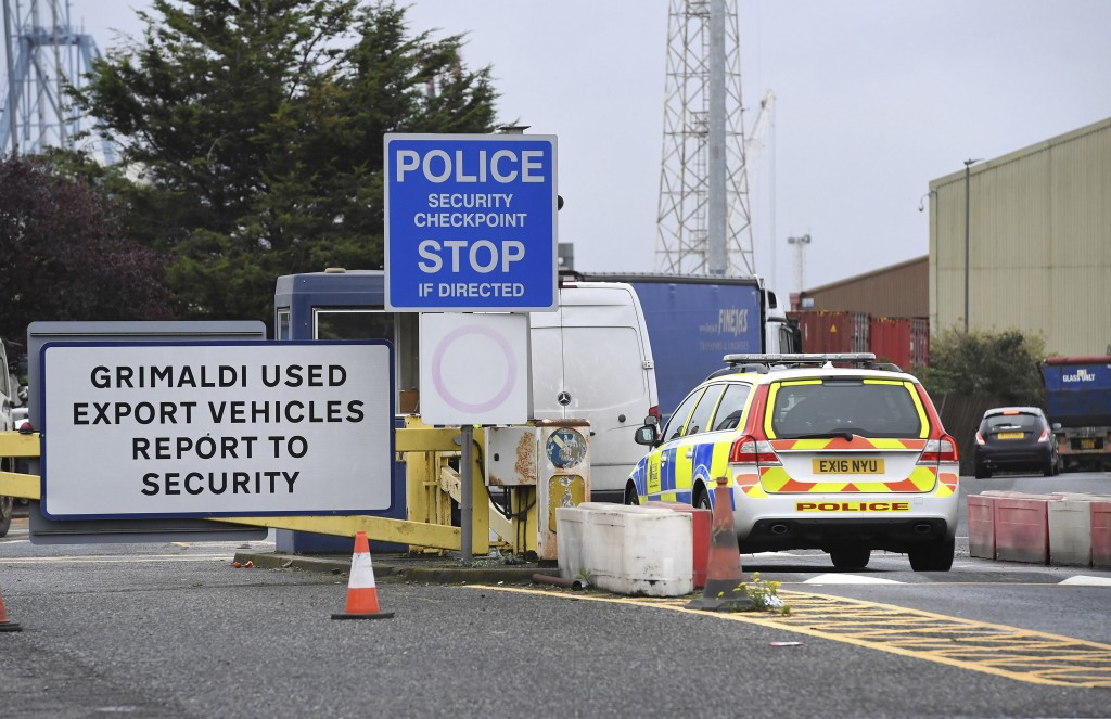 A police car enters the Port of Tilbury, where a shipping container with 39 people is thought to have entered England, near Grays, England, Friday Oct...