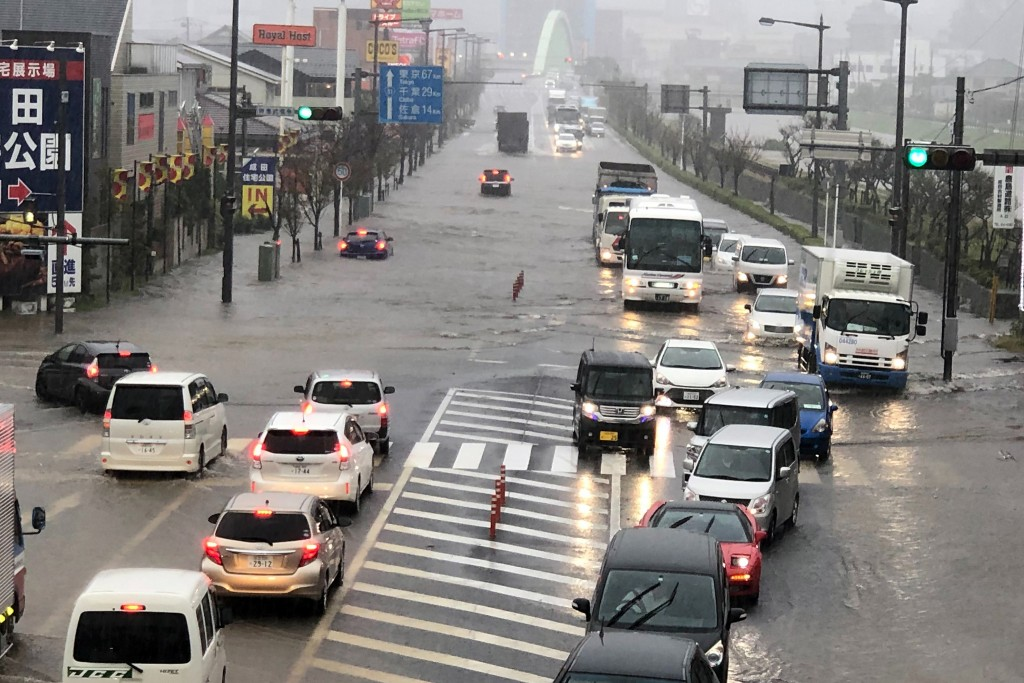 A street is flooded by heavy rain Friday, Oct. 25, 2019, in Narita, east of Tokyo. Torrential rain dumped from a low-pressure system hovering above Ja...