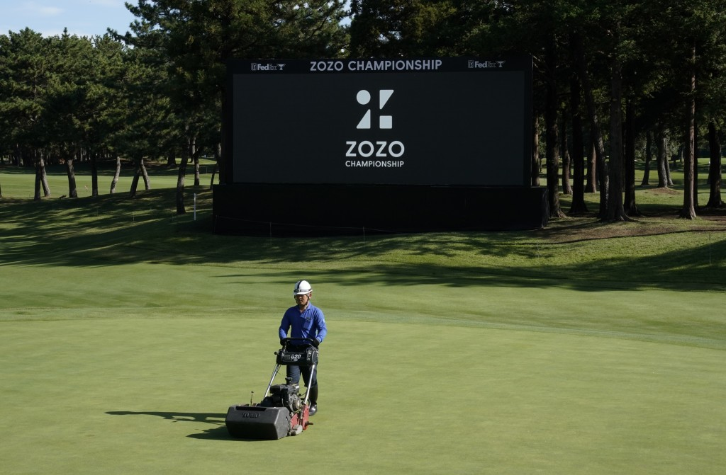 A member of grounds crew works on the 18th green before the start of the second round of the Zozo Championship PGA Tour at the Accordia Golf Narashino...