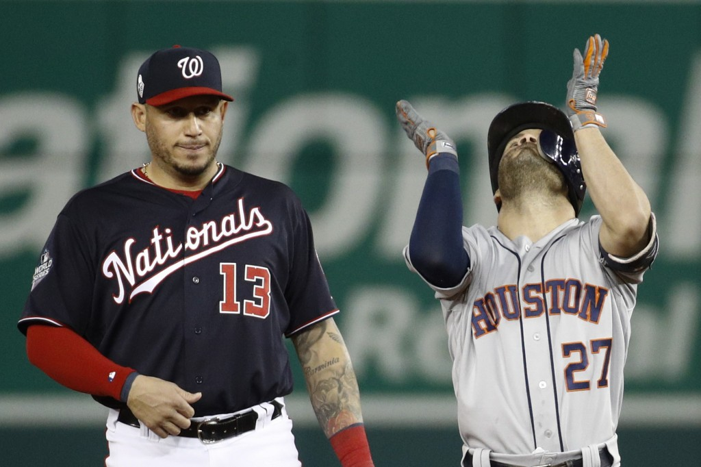 Houston Astros' Jose Altuve, right, celebrates next to Washington Nationals second baseman Asdrubal Cabrera after a double during the fifth inning of ...