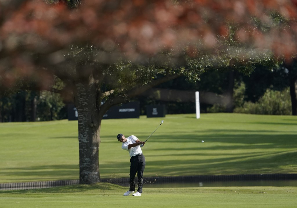 Tiger Woods of the United States watches his shot on the 4th hole during the second round of the Zozo Championship PGA Tour at the Accordia Golf Naras...