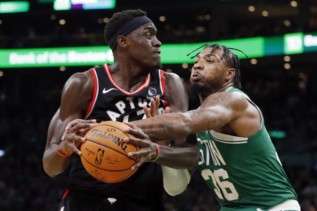 Boston Celtics' Marcus Smart (36) defends against Toronto Raptors' Pascal Siakam during the second half of an NBA basketball game in Boston, Friday, O...
