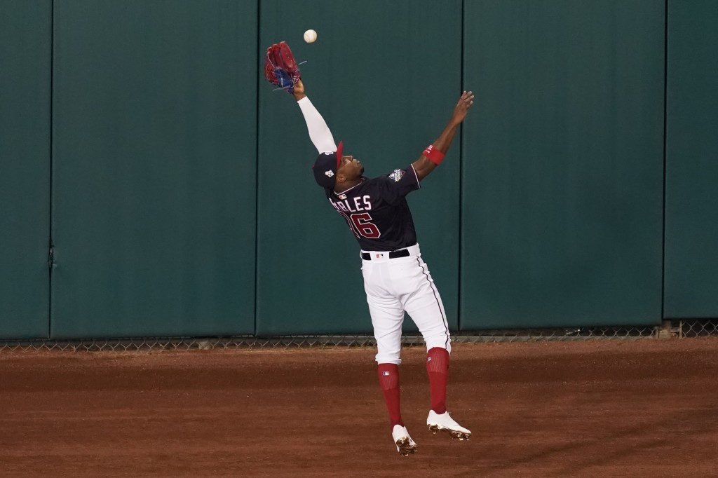 Washington Nationals' Victor Robles catches a fly ball hit by Houston Astros' Jose Altuve during the first inning of Game 3 of the baseball World Seri...