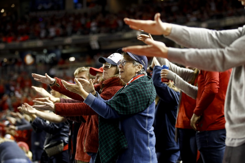 Fans gesture the baby shark as Washington Nationals' Gerardo Parra bats during the sixth inning of Game 3 of the baseball World Series against the Hou...
