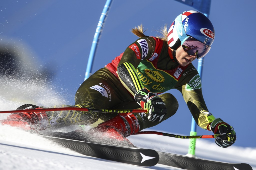 United States' Mikaela Shiffrin powers past a gate during an alpine ski, women's World Cup giant slalom in Soelden, Austria, Saturday, Oct. 26, 2019. ...