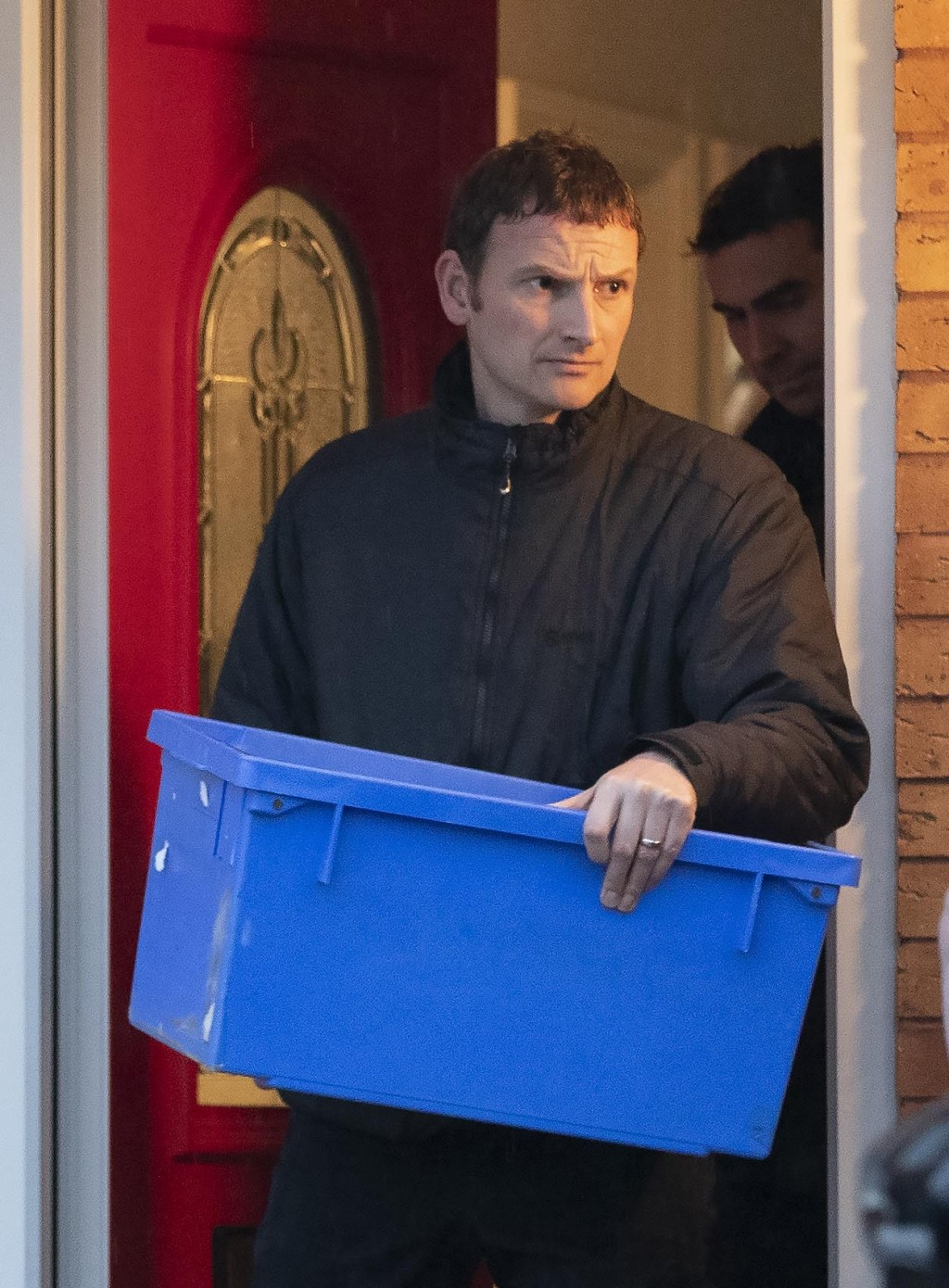 Police leave the home of Joanna and Thomas Maher with an evidence box at Wiltshire close in Warrington, Cheshire, Friday, Oct. 25, 2019, after a man a...