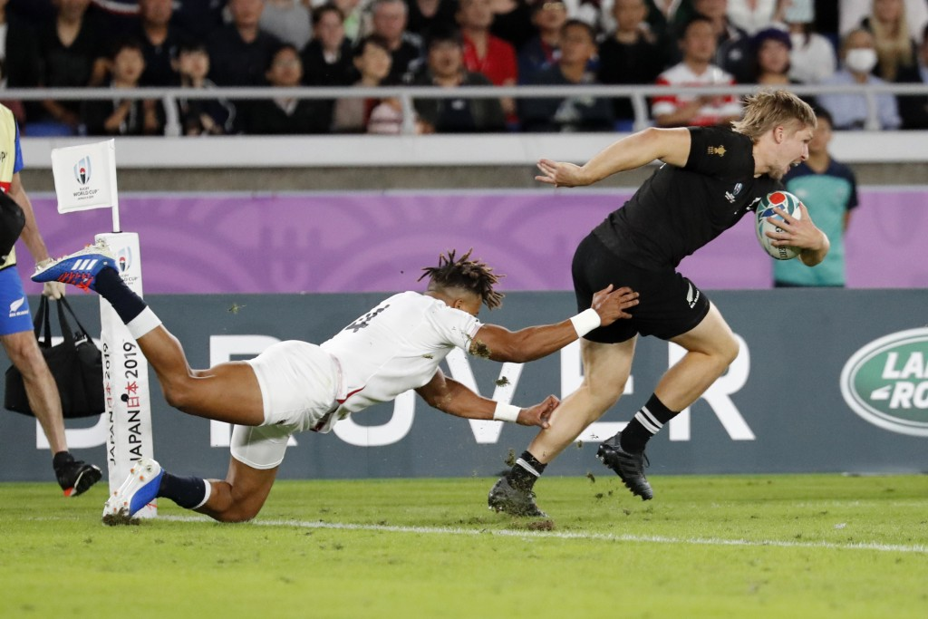 New Zealand's Jack Goodhue is tackled by England's Anthony Watson during the Rugby World Cup semifinal at International Yokohama Stadium in Yokohama, ...