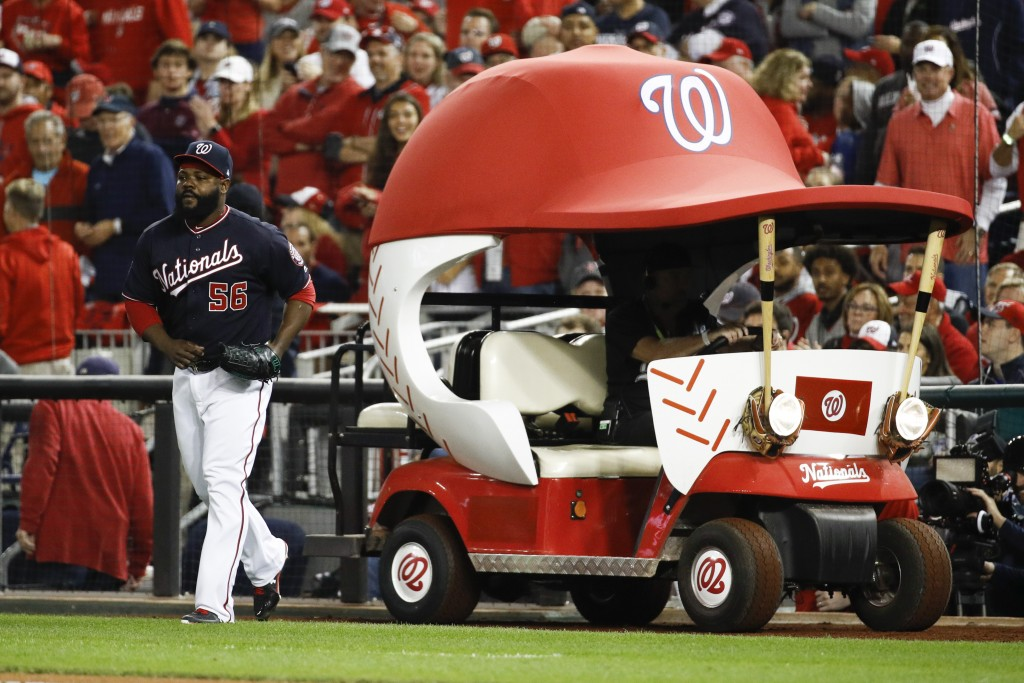 Washington Nationals relief pitcher Fernando Rodney gets out of the bullpen car as he come into the game during the sixth inning of Game 3 of the base...