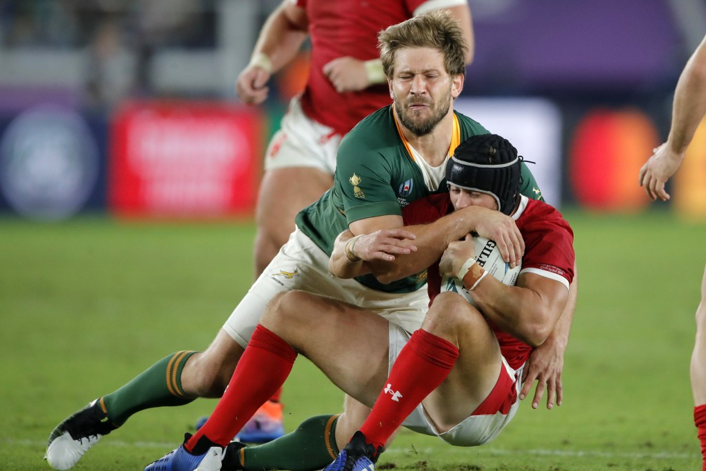 South Africa's Frans Steyn tackles Wales' Leigh Halfpenny during the Rugby World Cup semifinal at International Yokohama Stadium between Wales and Sou...