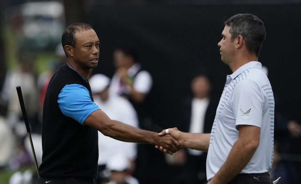 Tiger Woods of the United States, shakes hands with Gary Woodland of the United States on the18th hole after finishiing the third round of the Zozo Ch...