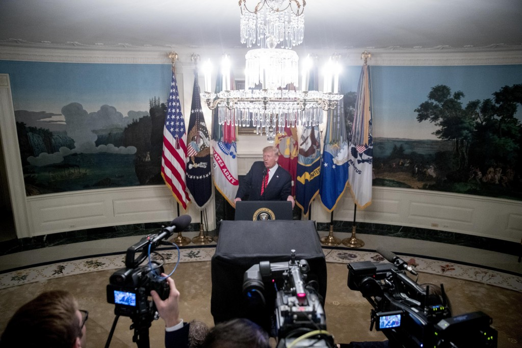 President Donald Trump speaks in the Diplomatic Room of the White House in Washington, Sunday, Oct. 27, 2019, to announce that Islamic State leader Ab...
