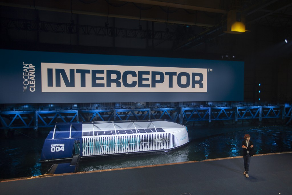 Young Dutch inventor Boyan Slat, right, unveils the Interceptor in Rotterdam, Netherlands, Saturday, Oct. 26, 2019. Slat is taking his effort to clean...