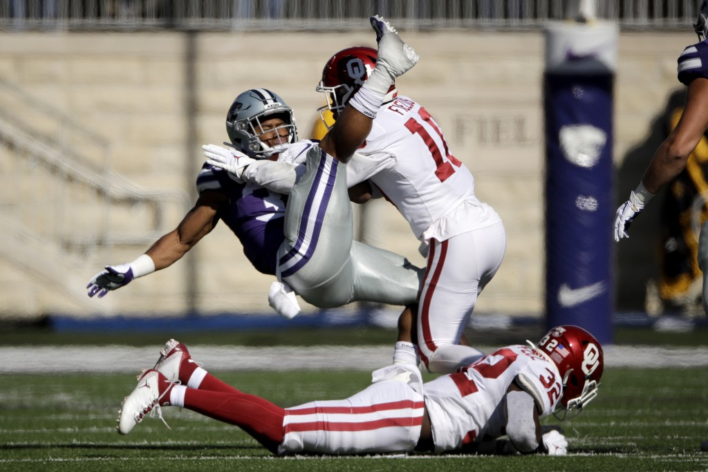 Kansas State running back James Gilbert is tackled by Oklahoma safety Pat Fields (10) during the first half of an NCAA college football game Saturday,...
