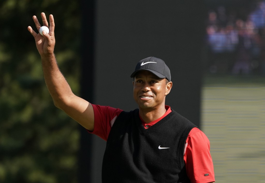 Tiger Woods of the United States reacts after his putt on the 18th hole during the final round of the Zozo Championship PGA Tour at the Accordia Golf ...