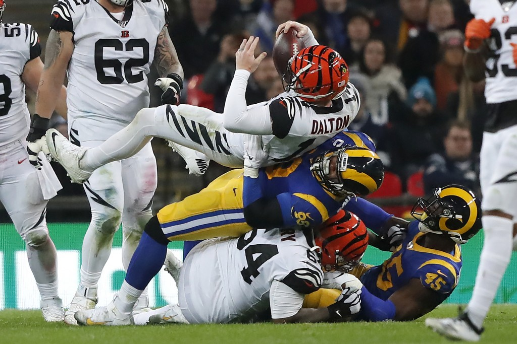 Cincinnati Bengals quarterback Andy Dalton, top, is sacked by Los Angeles Rams defensive tackle Aaron Donald during the second half of an NFL football...