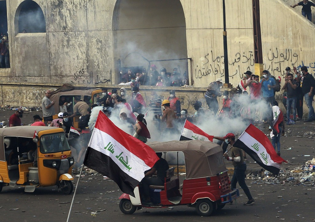 Iraq security forces fire tear gas to disperse anti-government protesters during a demonstration in Baghdad, Iraq, Monday, Oct. 28, 2019. Protests hav...