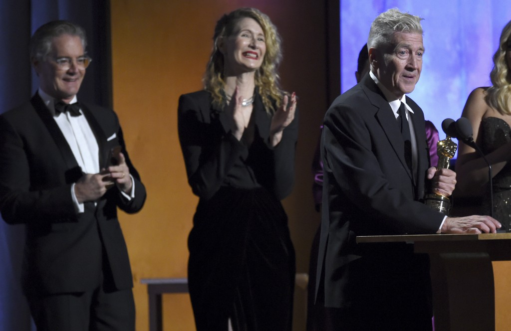 Director David Lynch accepts his honorary award as Kyle MacLachlan, from left, and Laura Dern look on at the Governors Awards on Sunday, Oct. 27, 2019...