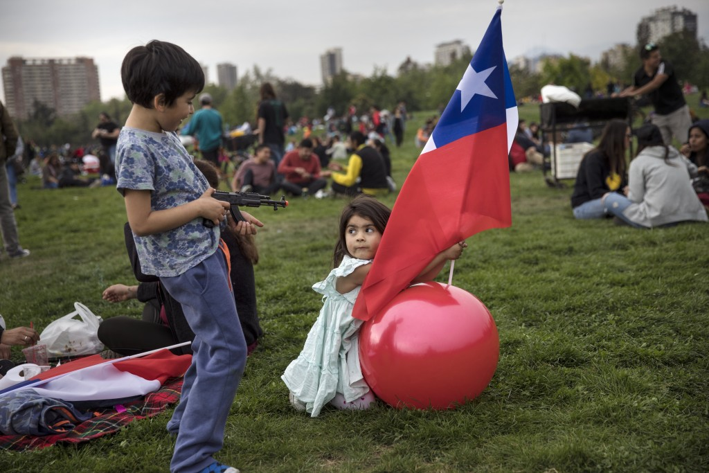 Children play in O'Higgins Park during an anti-government music concert in Santiago, Chile, Sunday, Oct. 27, 2019. Days of demonstrations have been ca...
