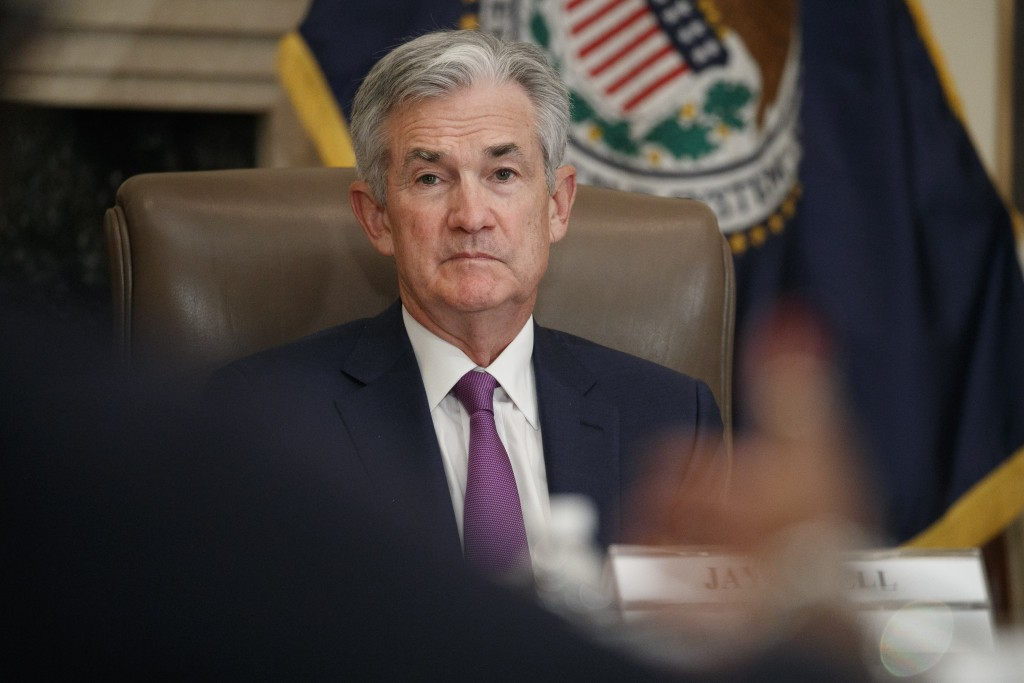 FILE - In this Oct. 4, 2019, file photo Federal Reserve Chairman Jerome Powell listens to feedback during a panel at the Federal Reserve Board Buildin...