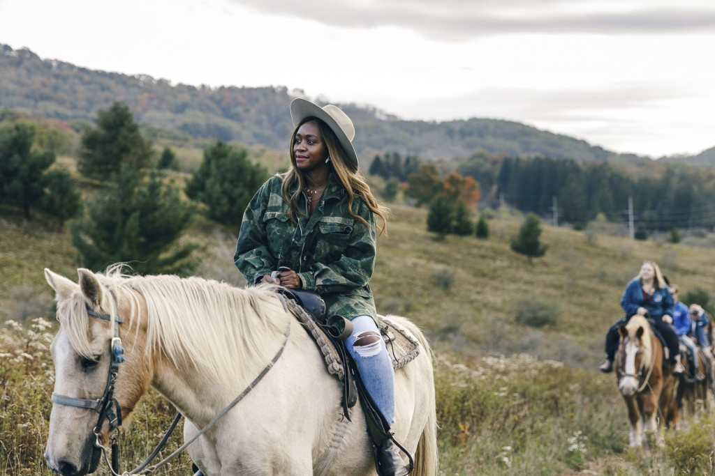 This Oct. 5, 2019 photo released by the West Virginia Division of Tourism shows Alicia Tenise horseback riding in Canaan Valley near Davis, W. Va. Ten...