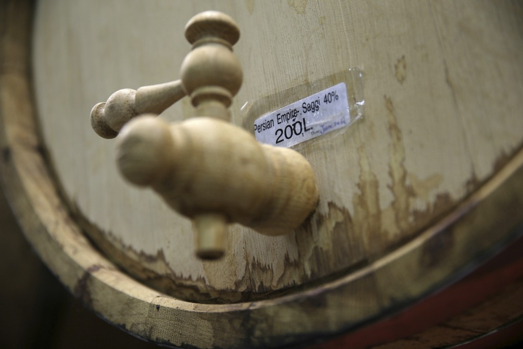 In this April 12, 2019 photo, an oak barrel holds aged 'Arak Saggi,' at the Persian Empire Distillery in Peterborough, Canada, about 130 kms (70 miles...