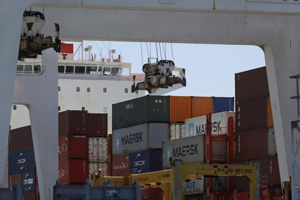 FILE - In this July 22, 2019, the container ship Kota Ekspres is unloaded at the Port of Oakland in Oakland, Calif. On Wednesday, Oct. 30, the Commerc...