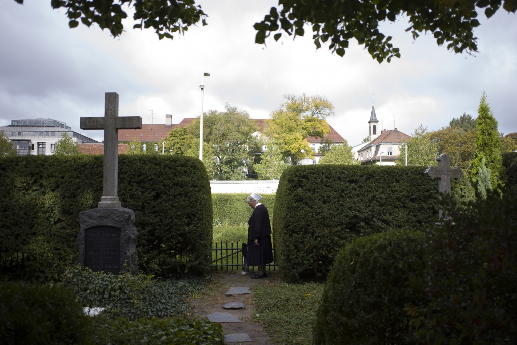 In this Sept. 18, 2019, photo, Sister Brigitte Queisser of the Lutheran Lazarus Order stands near graves of the Lazarus sisters during an interview wi...