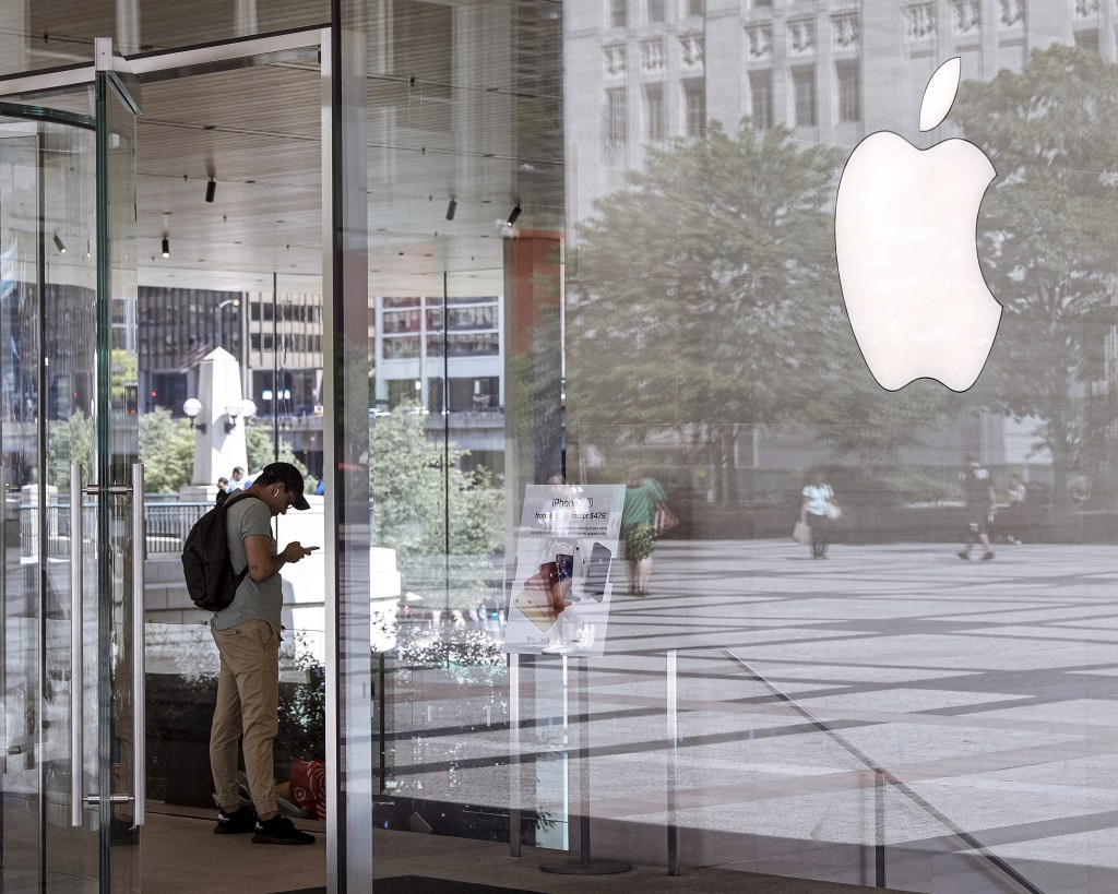 FILE - This July 24, 2019, file photo shows an Apple Store in Chicago is seen. Apple Inc. reports financial earns on Wednesday, Oct. 30. (AP Photo/Amr...