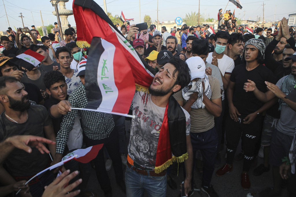 Anti-government protesters gather near Basra provincial council building during a demonstration in Basra, Iraq, Tuesday, Oct. 29, 2019. (AP Photo/Nabi...