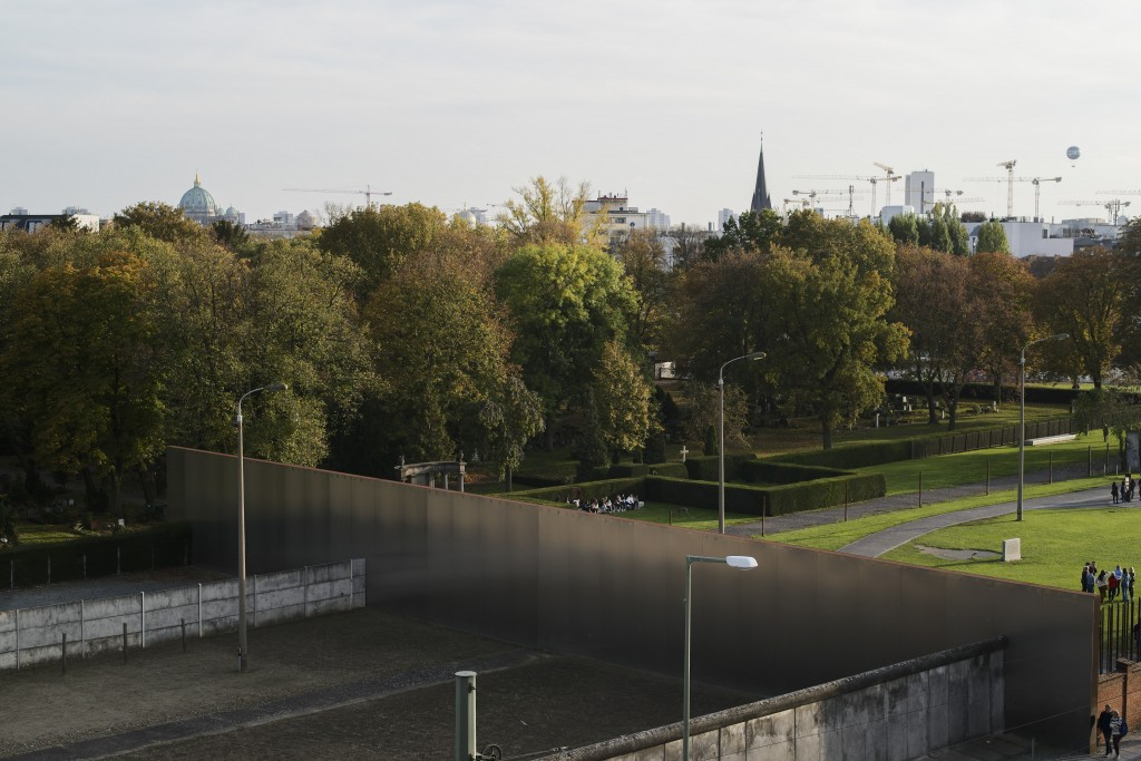 This Oct. 22, 2019, photo shows the graves of the sisters of the Lutheran Lazarus Order, next to the grey cross at the center right, in Berlin. During...