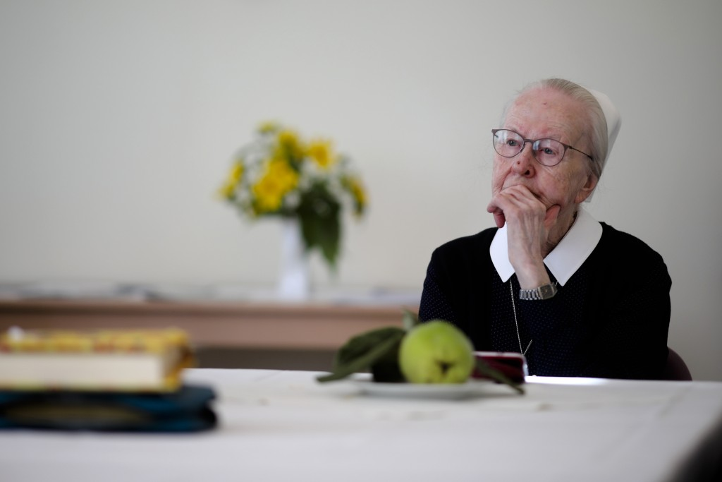 In this Sept. 18, 2019, photo, 84-year-old Sister Christa Huebner of the Lutheran Lazarus Order, which used to run a hospital across from the Berlin W...