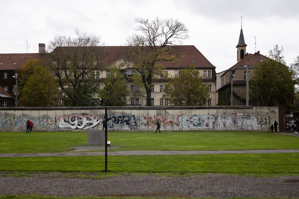 This Oct. 27, 2019, photo shows the Lazarus Sisters' mother house, background, on the west side of the city behind remains of the Berlin Wall, which a...