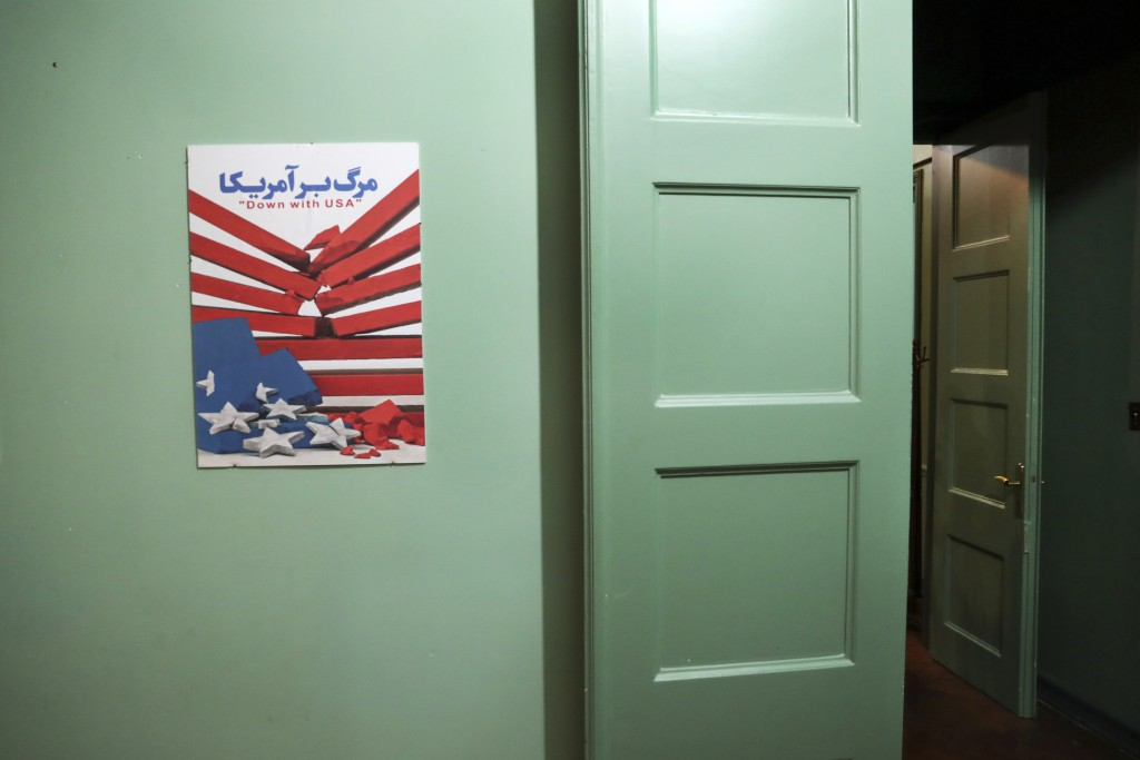 In this Sept. 26, 2019 photo, an anti-U.S. placard adorns a corridor of the former U.S. Embassy in Tehran, now partly a museum, in Tehran, Iran. The d...