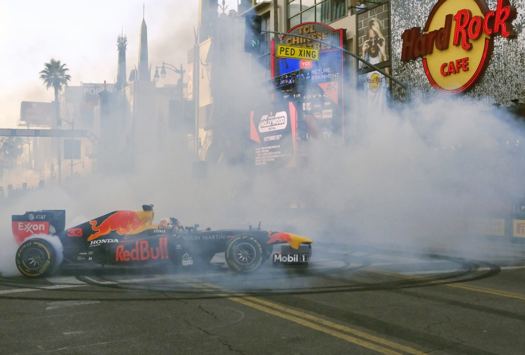 Red Bull Racing driver Max Verstappen does doughnuts along Hollywood Boulevard in front of the Hard Rock Cafe in the Hollywood section of Los Angeles ...
