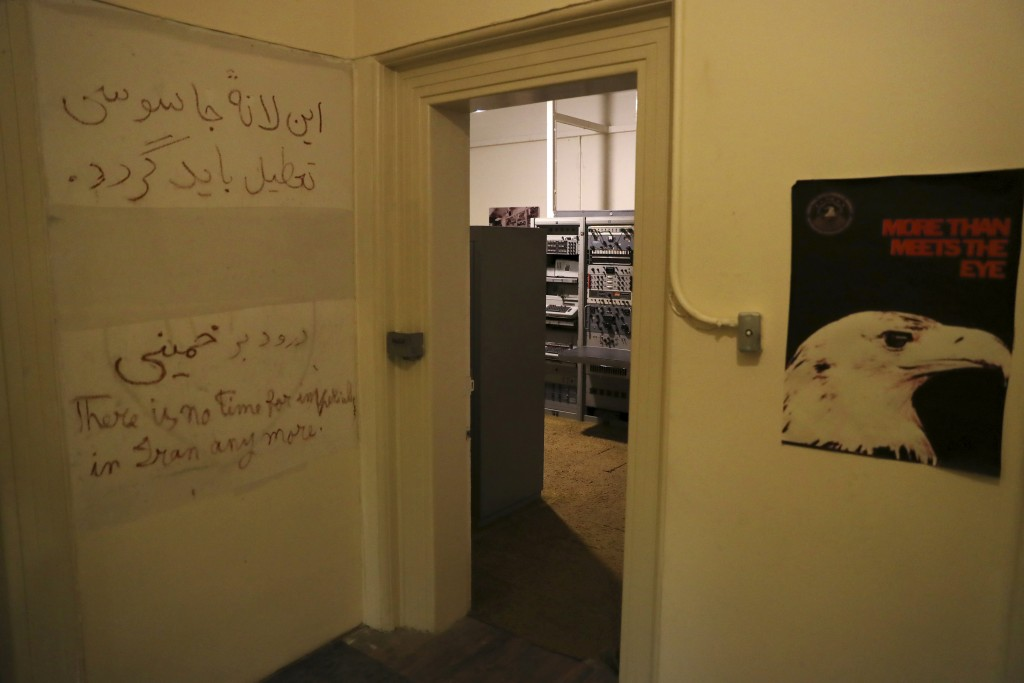 In this Sept. 26, 2019 photo, anti-U.S. slogans are written on the wall of a corridor of the former U.S. Embassy, now partly a museum, in Tehran, Iran...