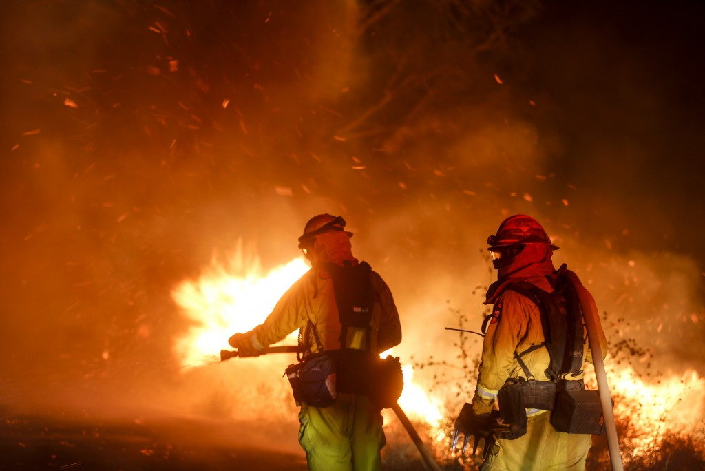 Firefighters battle a wildfire in Riverside, Calif. Thursday, Oct. 31, 2019. Santa Ana winds are expected to linger for a final day after driving more...