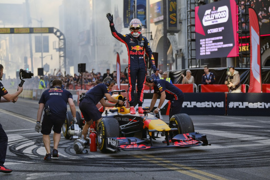 Red Bull Racing driver Max Verstappen waves to fans after doing doughnuts along Hollywood Boulevard in the Hollywood section of Los Angeles on Wednesd...