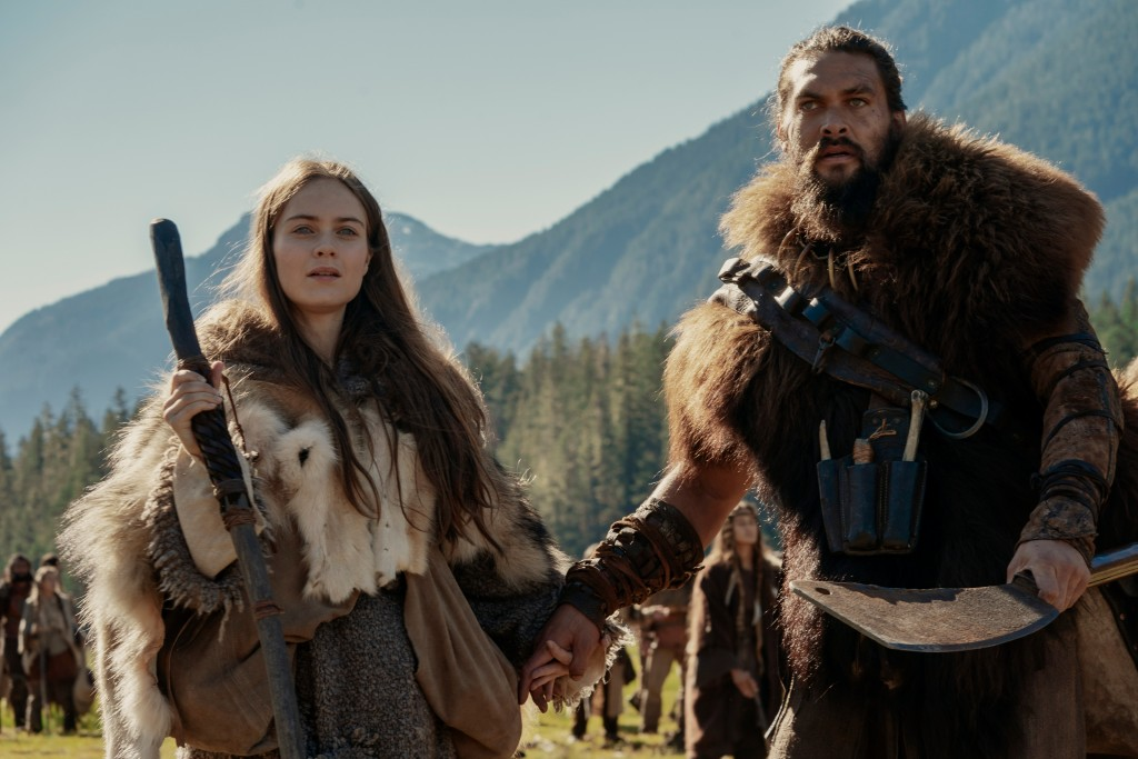 "This image released by Apple TV Plus shows Jason Momoa, right, and Hera Hilmar in a scene from ""See,"" premiering Friday, Nov. 1, 2019, on Apple TV Plu..."